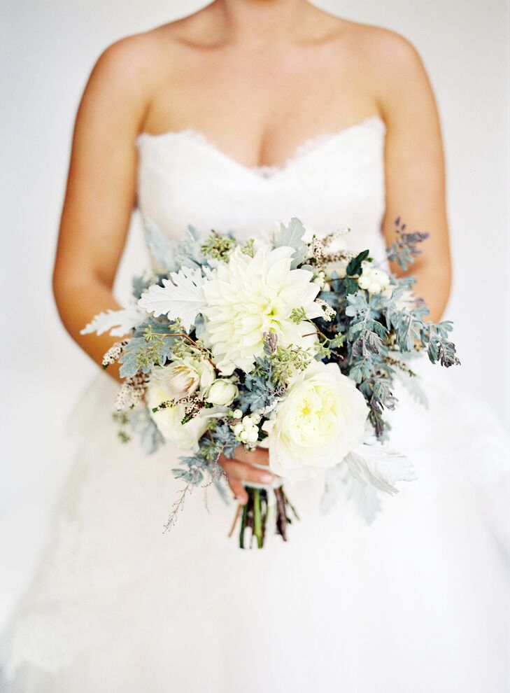 Kelly's bouquet mixed ivory dahlias and garden roses with rustic elements like eucalyptus seeds, dusty miller and pale gray accents for a textured, sophisticated look.