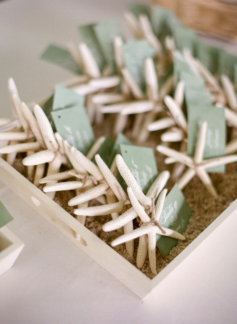 Starfish with paper tags used as wedding escort cards