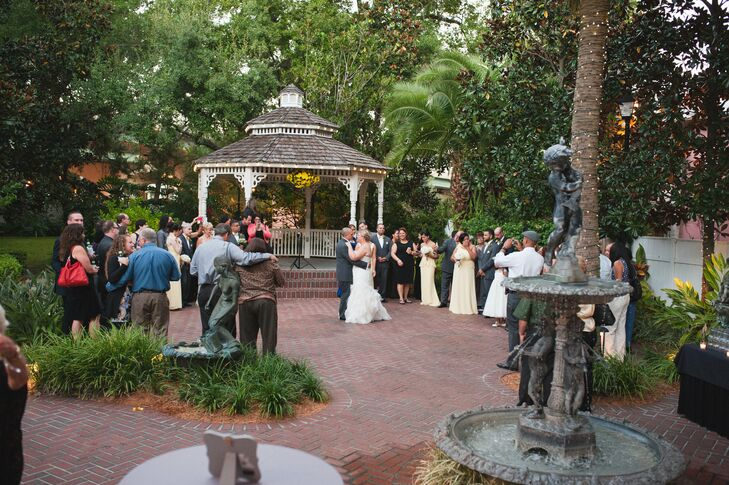"""After Kimberlee and Hegel said """"I do,"""" they transformed the Courtyard at Lake Lucerne in Orlando, Florida, from a ceremony space into a dance floor. The couple loved having the opportunity to sway around the natural setting and pop inside for an intimate dinner with their guests."""