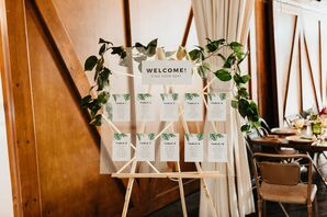 Acrylic Seating Chart with Tropical Paper and Greenery