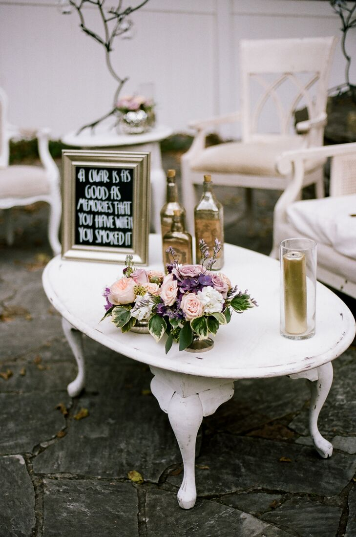 Ashley and Sean created vignettes throughout the CJ's open-air pavilion where guests could kick back while enjoying signature cocktails like peach sangria and whiskey sours. Vintage furnishings in a warm off-white hue felt undeniably elegant, while details like gilded bottles and pillar candles delivered undeniable wow-factor and glamour.