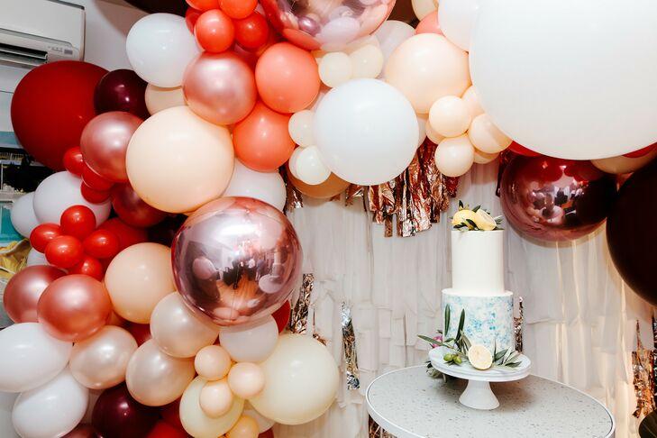 Cake Display with Balloon Garland at Wedding in Australia