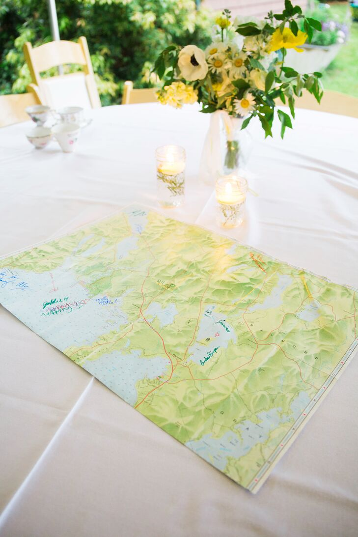 While a British tea-party theme dominated the day, subtle nods to the couple's Maine roots were woven throughout the day. In lieu of a traditional guest book, Emma and Graham invited their guests to sign a vintage map of Sebago Lake, where the wedding was held.
