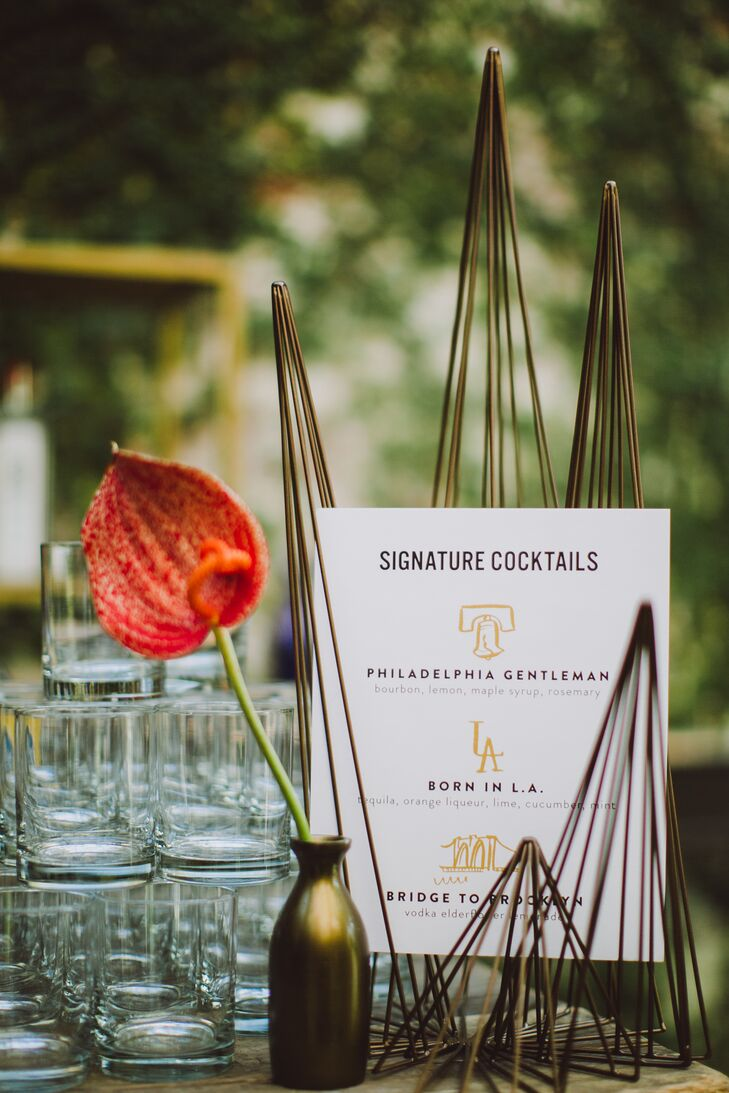 The same typeface and modern aesthetic of the invitation suite, escort cards and menus presented the signature drinks during cocktail hour: Philadelphia Gentleman, Born in L.A. and Bridge to Brooklyn. Each creative drink name harked back to the couple's hometowns.