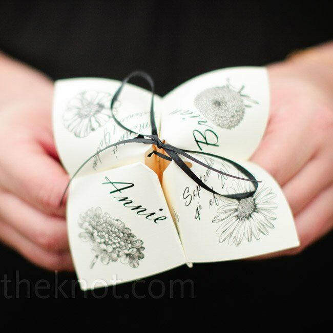 The programs were printed on cootie catchers! Each petal held information about the bridesmaids, the groomsmen, and the ceremony, plus a special thank-you to guests.