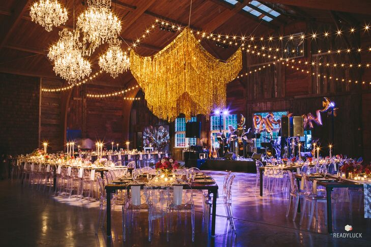"""Amy and Geoff's reception was held in old racing stables at Cedar Lakes Estate in Port Jervis, New York. """"It has been beautifully restored by the sisters who own the venue, and it has a really cool Brooklyn vibe while being in the middle of the woods,"""" Amy says."""