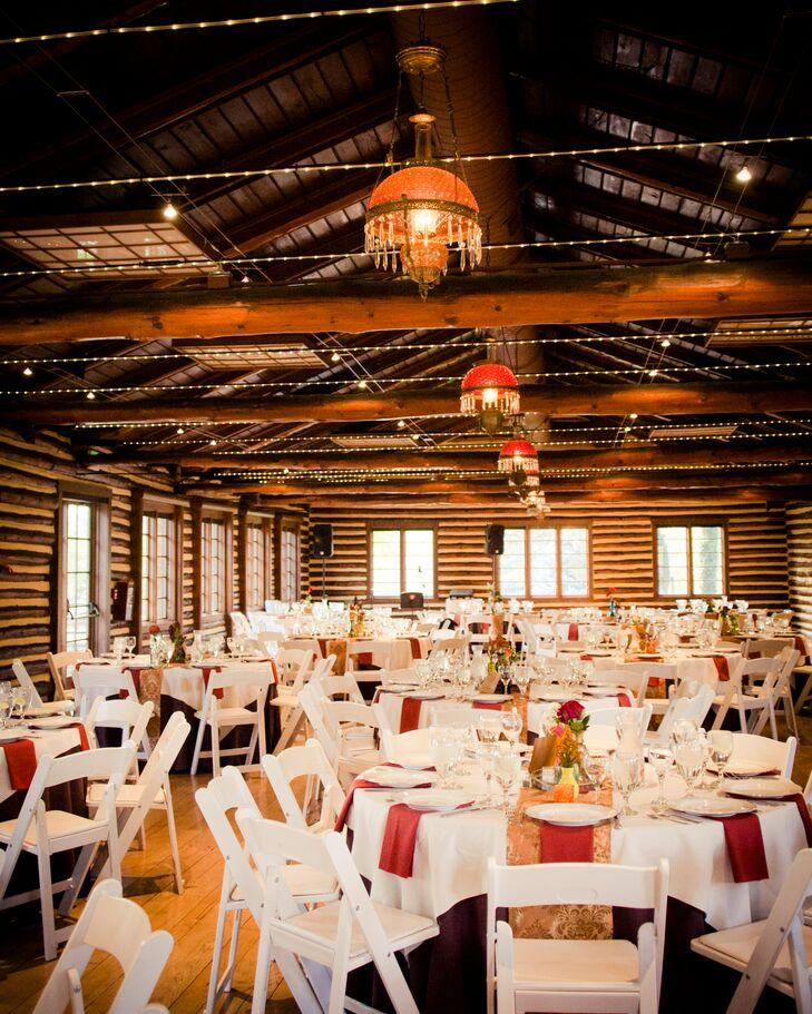 Brooklyn and Steve loved the old, historical log cabin at The Hudson Gardens and Event Center in Littleton, Colorado. It had been completely renovated and even had two fireplaces inside, which added to the autumn ambience. The couple also loved the orange and red vintage chandeliers that perfectly complemented their color palette and vintage centerpieces.