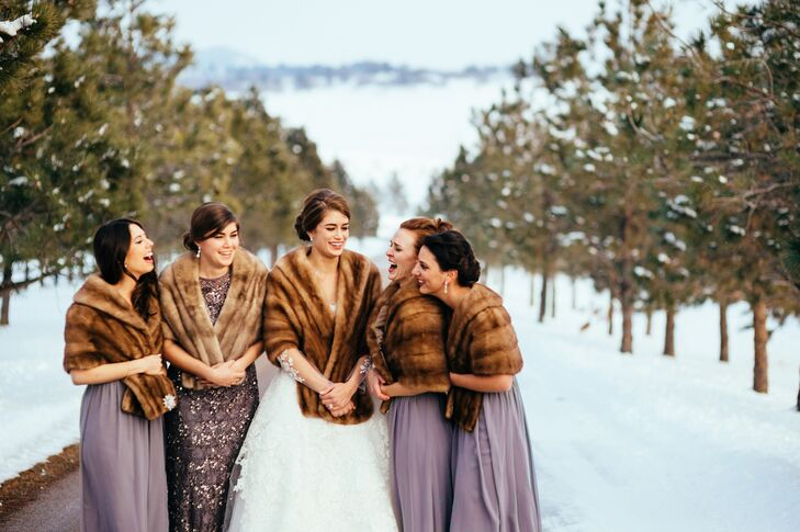"""The bridesmaids wore long Donna Morgan dresses in sterling, and my sister, my maid of honor, wore a different dress,"" Meagan says. ""She was in a special beaded dress of the same color, which I loved. My sister is my best friend, and I was happy to have her stand out and look so beautiful at the wedding. They all wore fur wraps as well that my mom had found. The vintage furs were all slightly different, but went well together."""