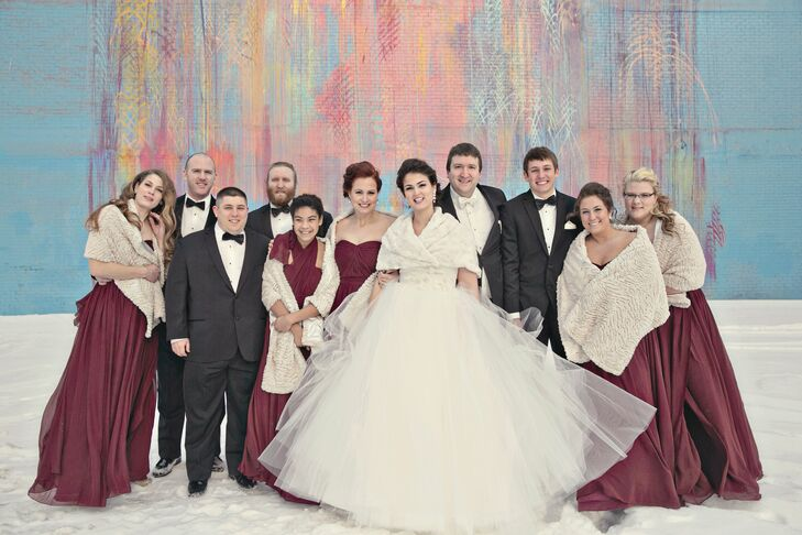 Emily and her attendants accessorized their gowns with ivory wraps to ward off the winter chill. The groom and groomsmen kept it classic in traditional black tuxedos.
