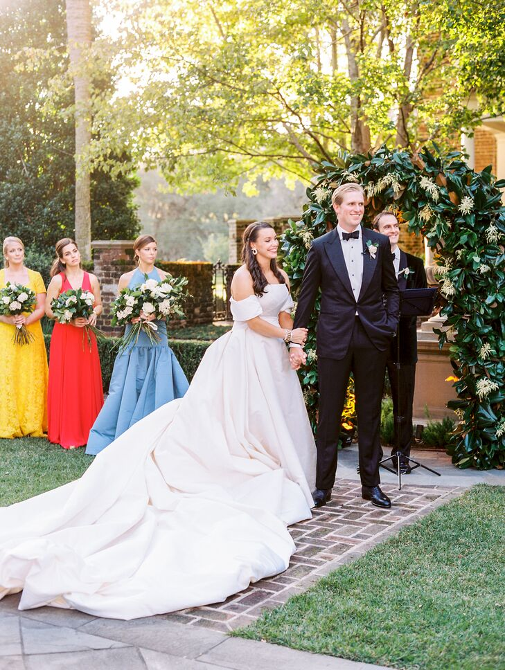 Couple at Formal Outdoor Ceremony at Fenwick Hall in Johns Island, South Carolina
