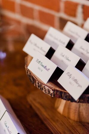Calligraphed Escort Cards on Wood Stand