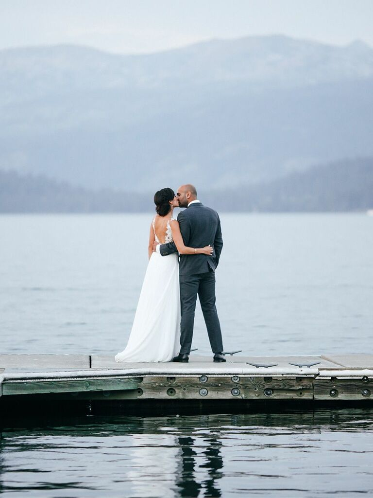 bride and groom kissing on a dock Idaho