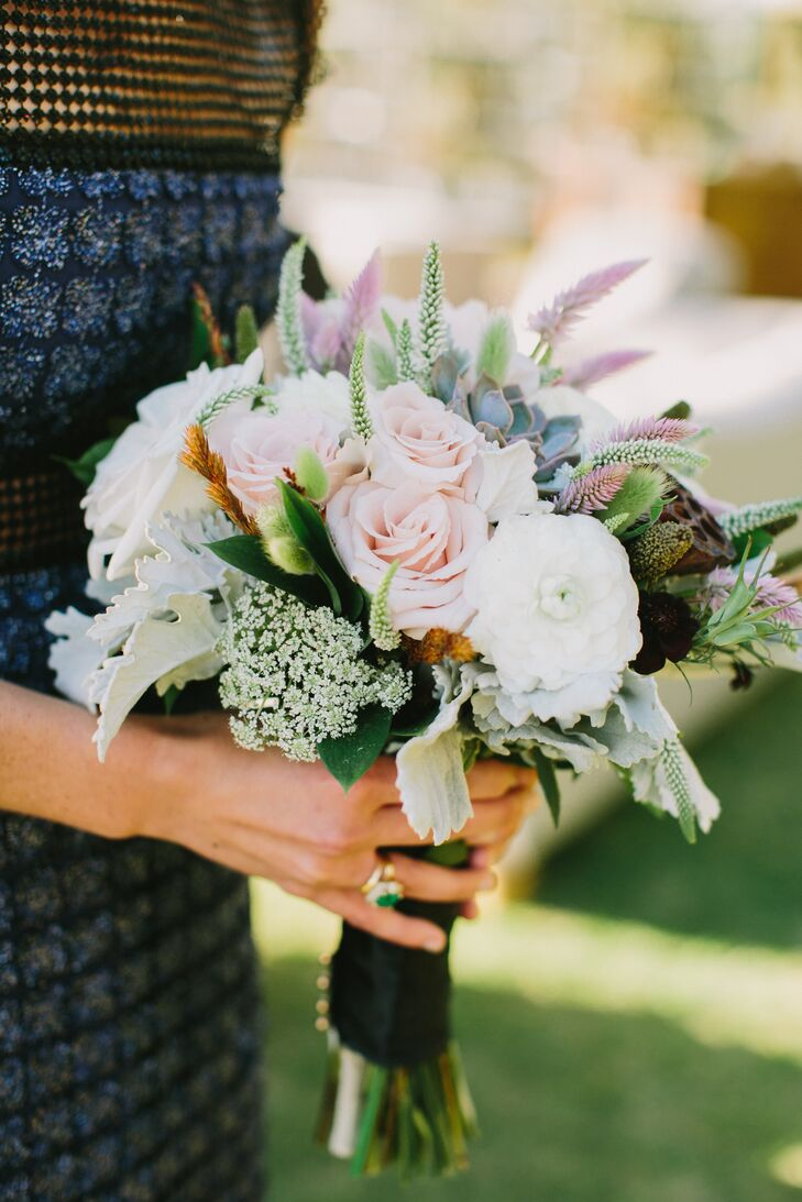 Bridal and bridesmaid bouquets were meant to have a freshly picked wildflower appearance. Each was made with pale pink and white blossoms, all locally sourced.