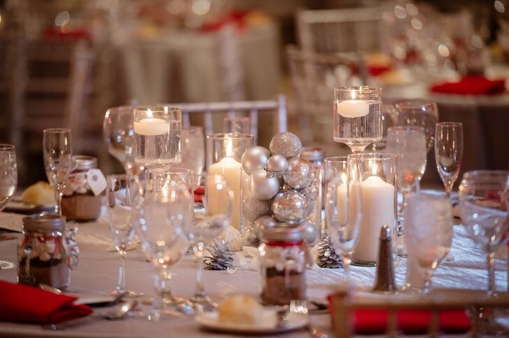 Vases filled with silver ornaments added festivity to the reception tables without feeling like guests walked into a Christmas store. Candles kept the mood warm and cozy.