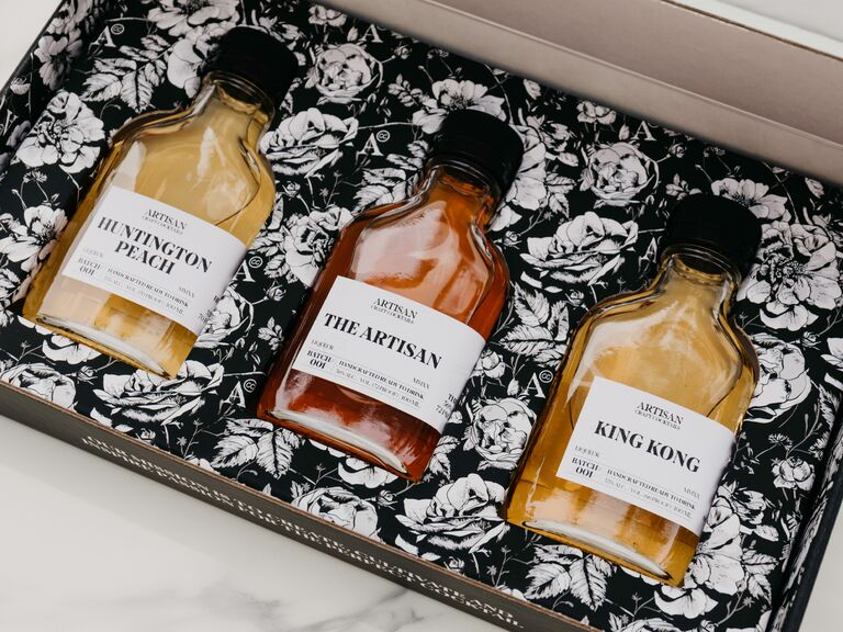 Three bottles of different craft cocktails in a floral gift box Valentine's idea