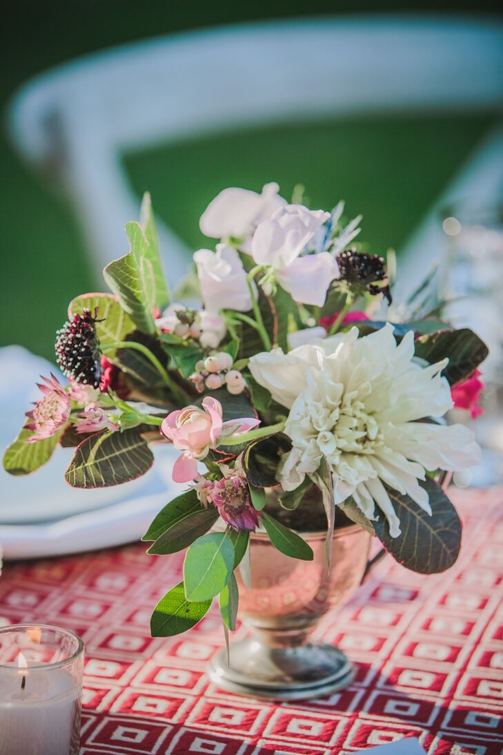 Bouquets were designed with a lush mix of pinks, ivories, hints of coral, and overspilling greenery.