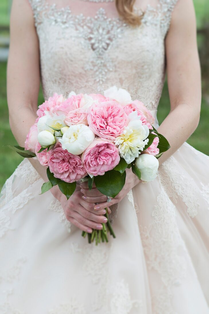 The bride chose pink Juliette roses and white dahlias and peonies for her bouquet. These matched the pink and cream invitations and RSVP cards, which also featured peonies.