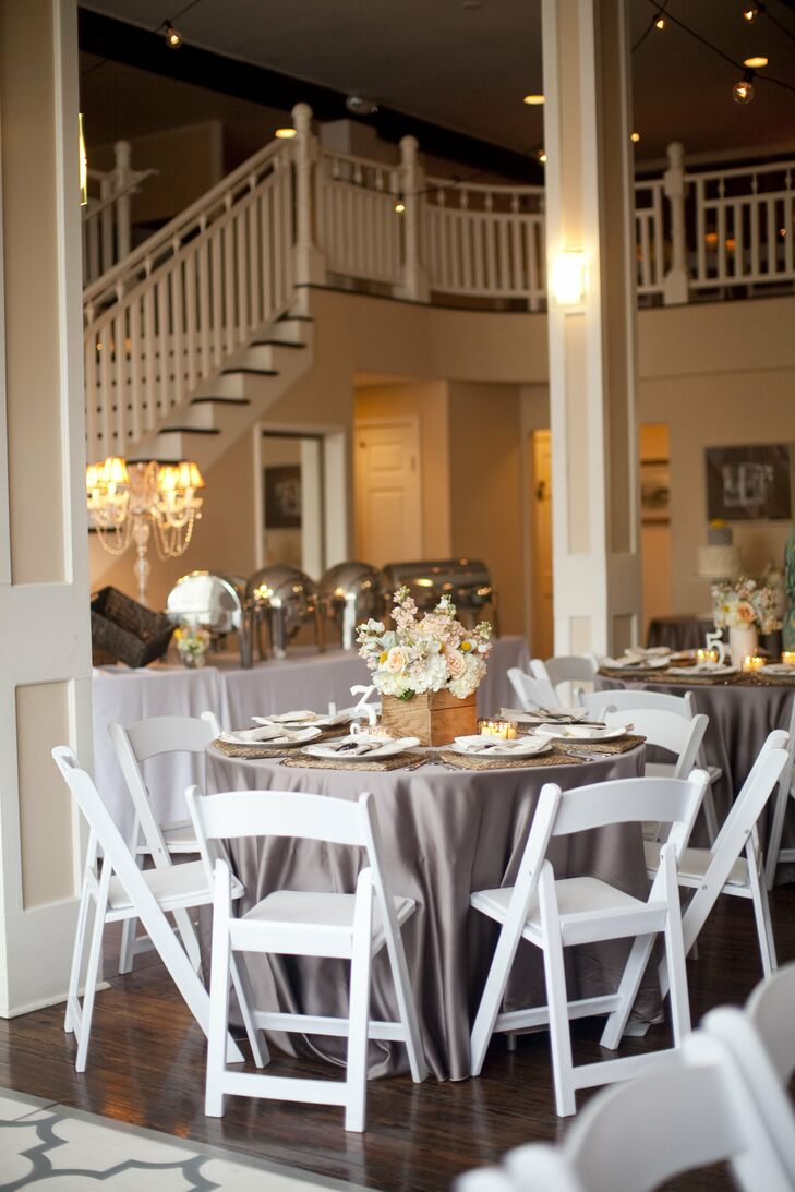 Tables were topped with warm-gray linens, sea-grass chargers and votives.