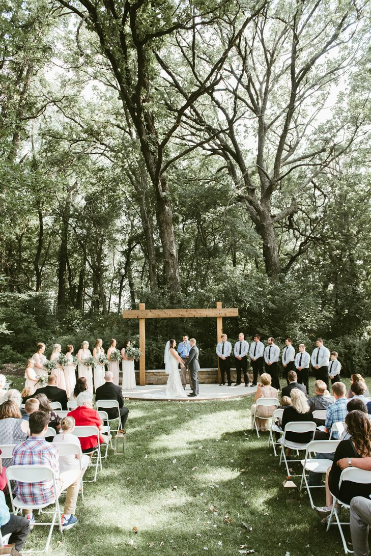 Trisha and Nic said their vows outdoors under a simple wooden altar.