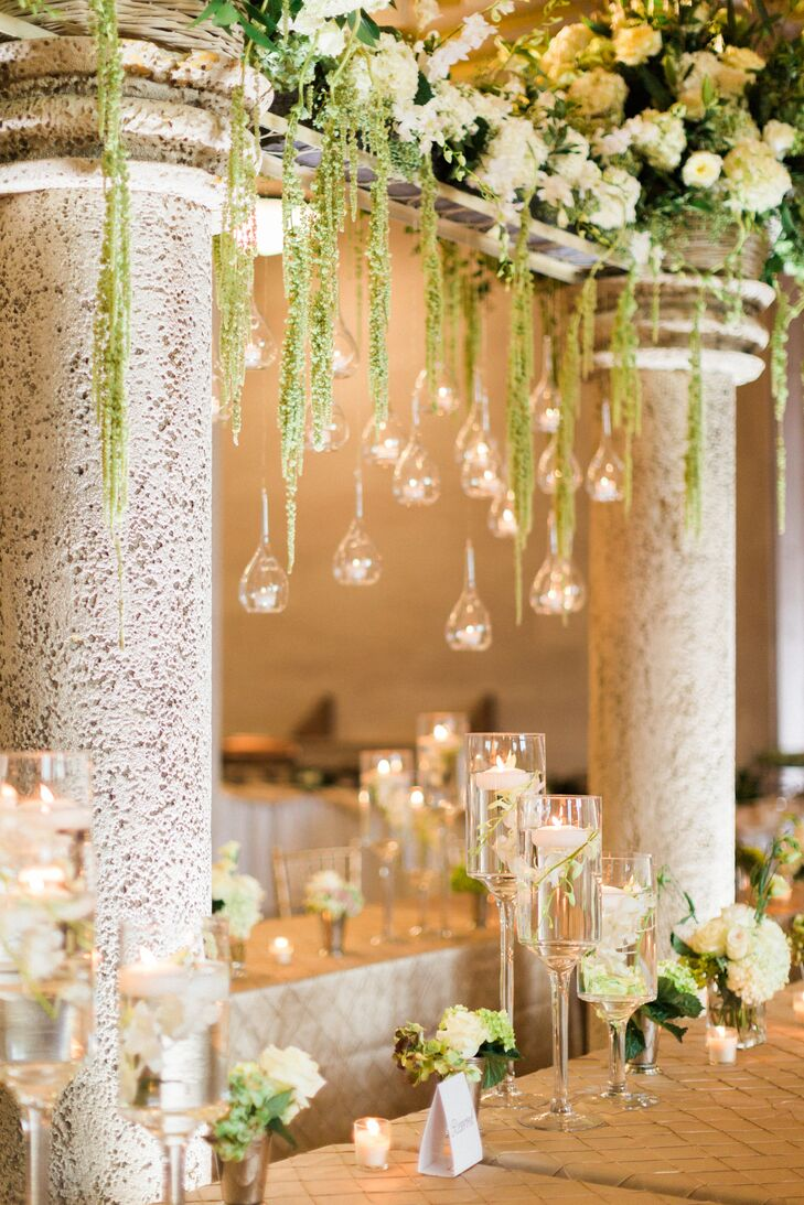 "Hanging candles were the ""jewels"" of the oversized centerpieces and made the entire room sparkle after dark."