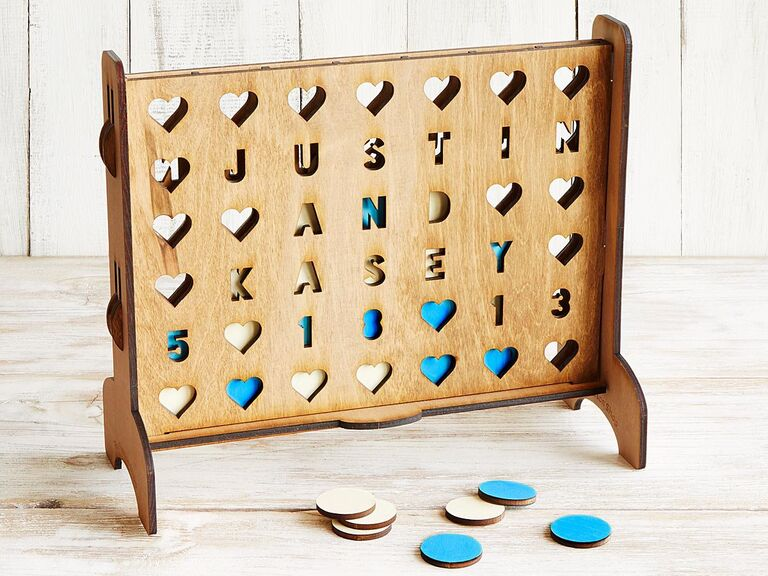 Wooden four across game personalized with couple's names and wedding date as the holes