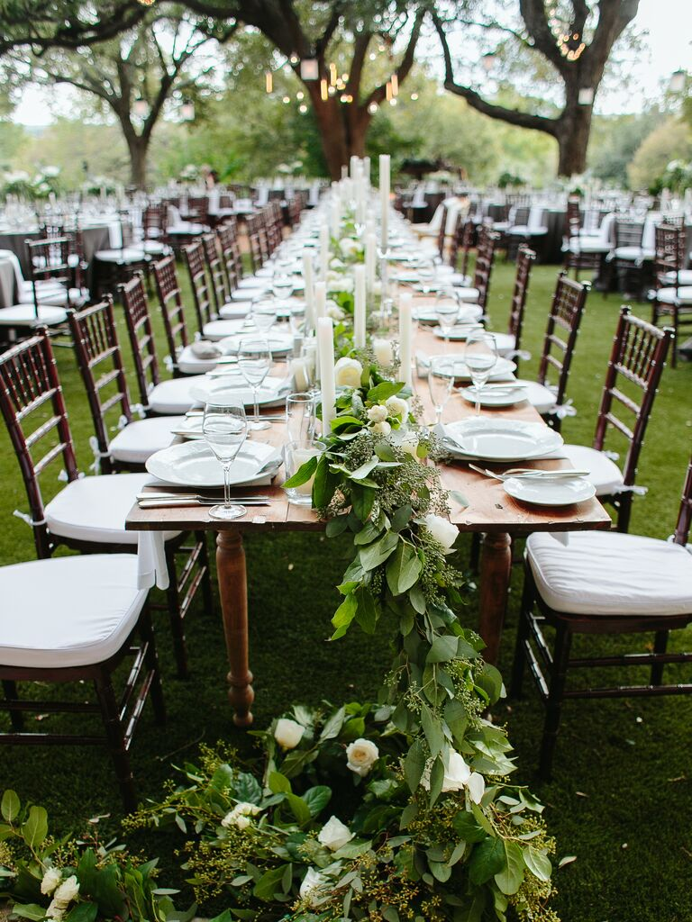 Tall candlesticks with low white hydrangea centerpieces