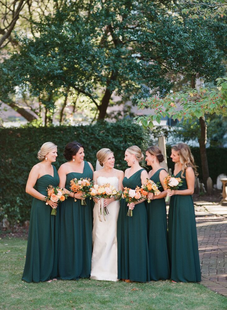 """Kathryn's five bridesmaids wore the same floor-length, hunter-green dress. """"I gave them the choice between five different dresses and they all independently picked the same one!"""" she says. For their jewelry, Kathryn gave them tortoiseshell earrings with rhinestone and gold and tortoiseshell monogrammed bracelets."""