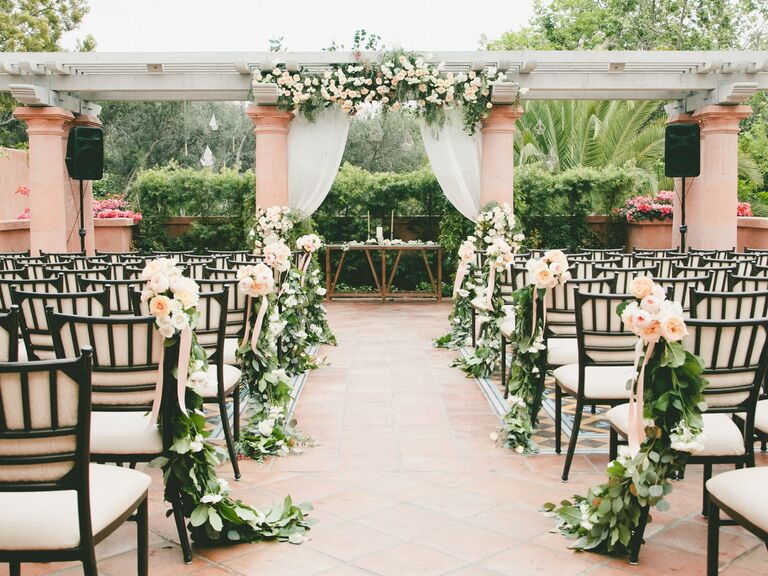 Greenery With Peach and White Blossoms ceremony aisle decor