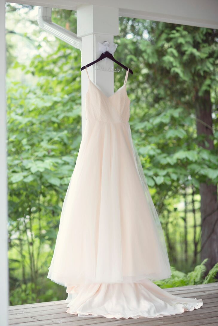 Heather wore a strappy Ivy & Aster dress called Duchess, which she customized with a longer train and french bustle. The pale blush color is just barely noticeable in the sunlight, but looks absolutely stunning next to the pastel bridesmaid dresses.
