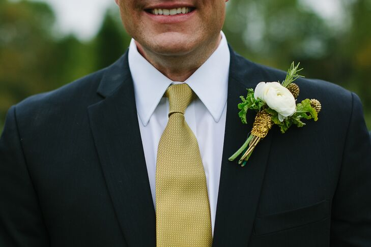The groomsmen wore a white ranunculus boutonniere complemented by assorted greens.