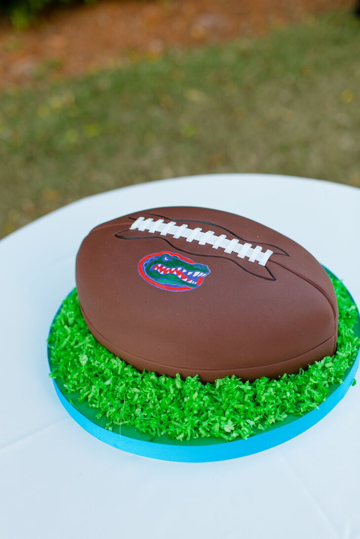 This celebration was not without a few surprises. Until their reception, Andy had no idea that Kakes by Karen had baked him a coconut and raspberry buttercream groom's cake that was inspired by the University of Florida's football team, the Florida Gators.