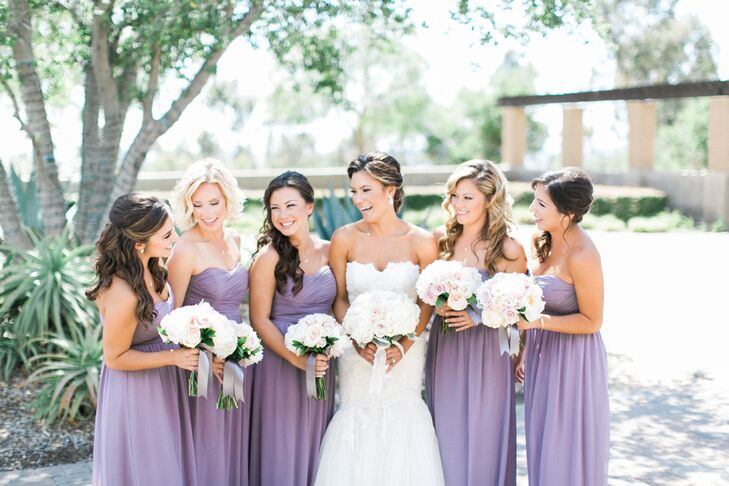 Bree's five bridesmaids wore flowing, full-length strapless lavender gowns that matched the delicate palette of cream and blush pink.
