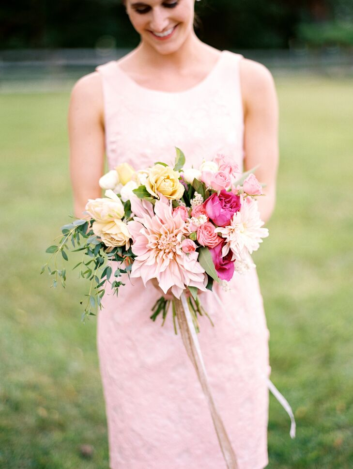 The bridesmaids' bouquets had a similar romantic, whimsical feel to Kristina's and were filled with full blooms like dahlias, roses and ranunculuses in shades of pink, peach, ivory and cream.