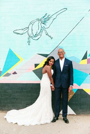 Modern Couple Posed in Front of an Urban Mural