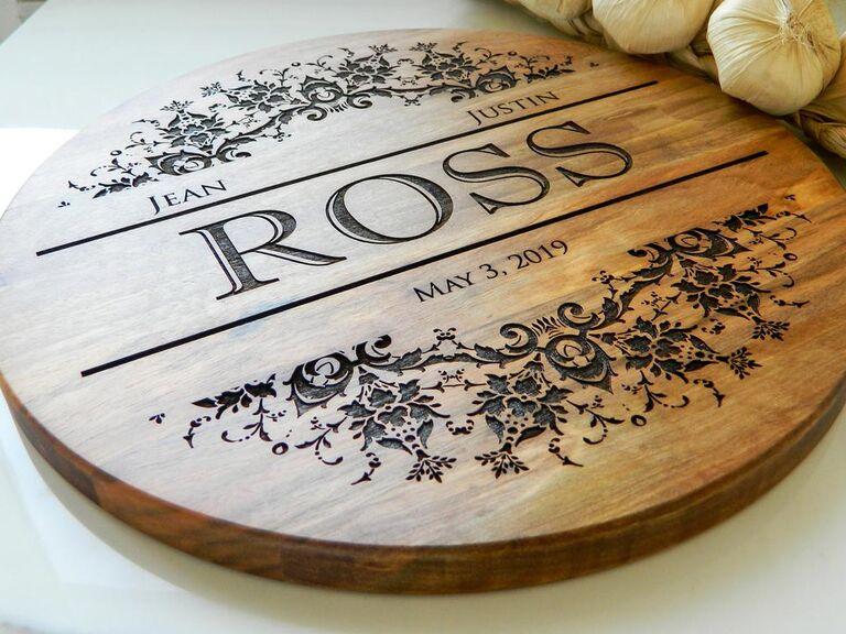 Engraved round wooden wedding cake board
