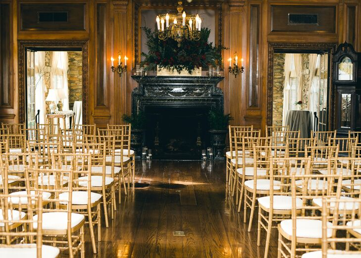 Wood paneled walls and an elegant fireplace decorated with a lush floral arrangement lent the ceremony an air of old-world charm.