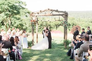 Romantic First Kiss Beneath Log Arch at Red Maple Vineyard
