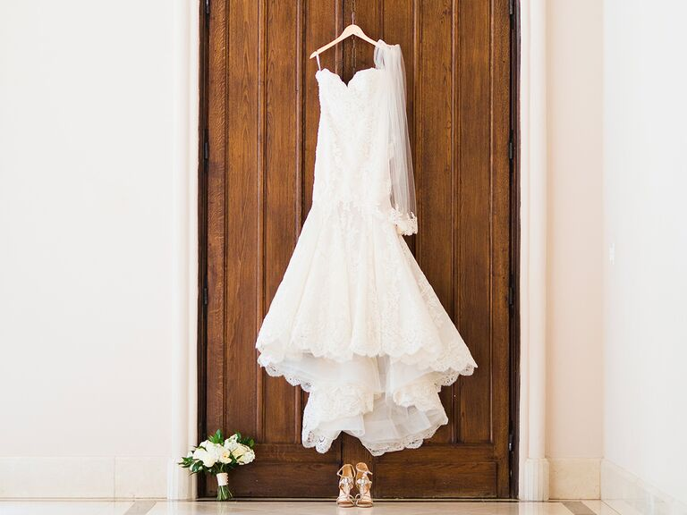 Strapless lace wedding dress on a hanger