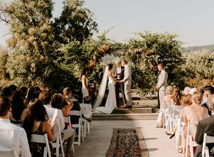 Natalie and Ryan's wedding at Tin Roof Barn in White Salmon, Washington, embodied the coziness of home with its boho-chic reception decor and beige-an