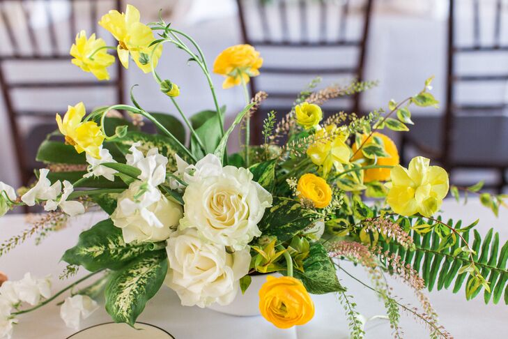 Modern Centerpiece of Yellow Ranunculus, Daffodils, Roses and Ferns