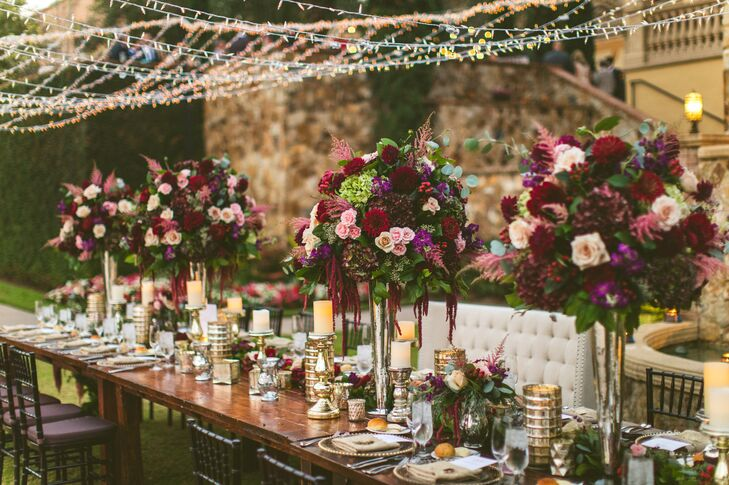 Wood Reception Tables with Tall Fall Centerpieces and String Lights Overhead