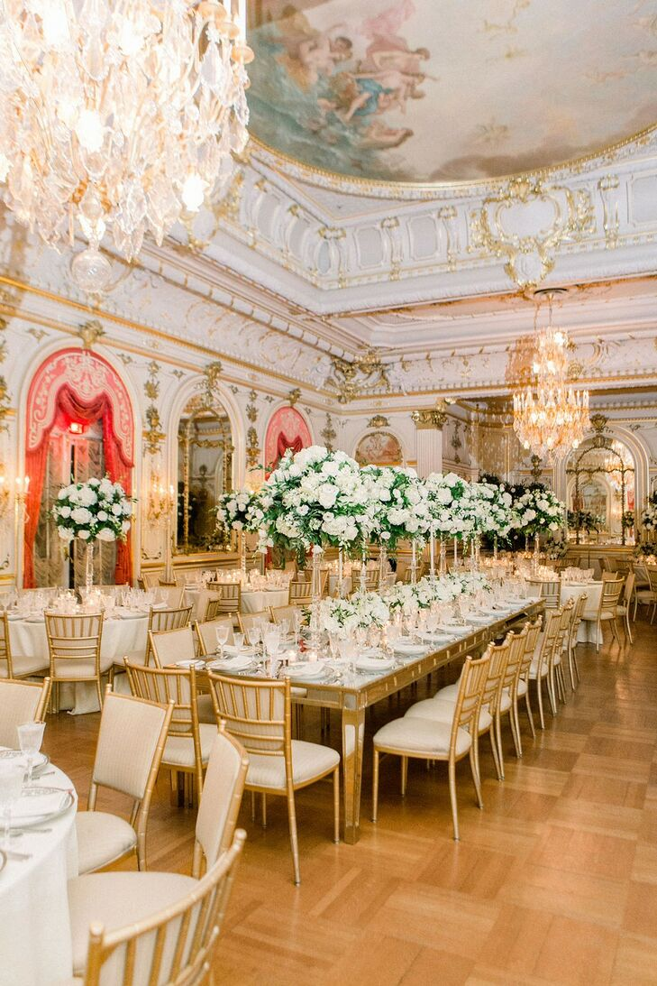 Glamorous Reception with Tall Centerpieces, Chandeliers and Gold Chiavari Chairs