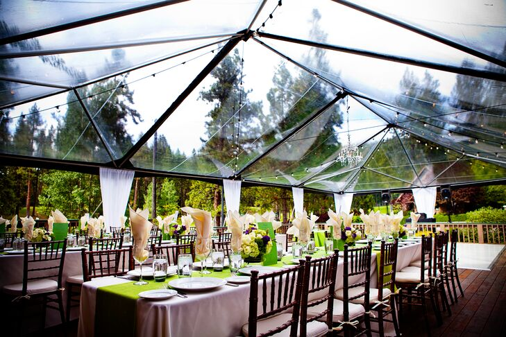 The reception decor was centered on a clear tent to cover the deck so guests could see the stars. A crystal chandelier and hanging string lights hung in the tent and surrounding area. The couple had extra-long tables to make it feel like a family-style dinner.