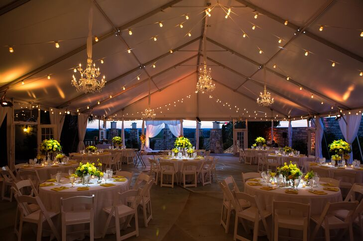 """""""We viewed our wedding as the first party we'd throw together as a new family,"""" says the bride. Their reception took place in the courtyard at One World Theatre surrounded by stunning views of the Texas Hill Country."""