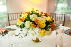 Bright Rose and Hydrangea Centerpiece in Gold Urn
