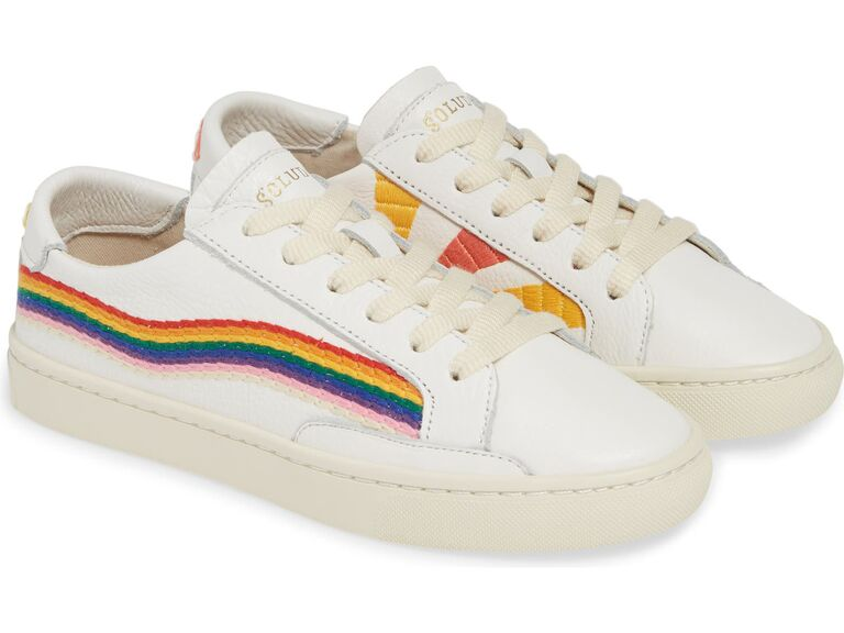 White bridal sneakers with rainbow and sunshine motifs