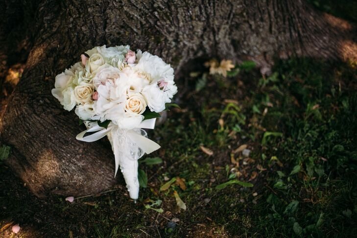 Morgan carried a bouquet of white roses and peonies, tied with a giant white satin ribbon bow.
