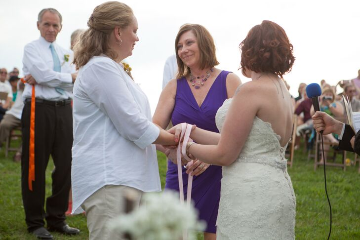 As a symbol of their union, Jennifer and Whitney opted to incorporate a hand-fasting tradition into the ceremony. Each of the their immediate family members joined them at the ceremony altar where they shared a value that they hoped would be present in the marriage, while wrapping a colored ribbon around the brides' intertwined hands.