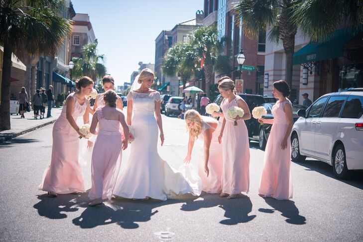 Caitlin's chiffon bridesmaid dresses set the tone for their romantic petal pink and silver color palette.