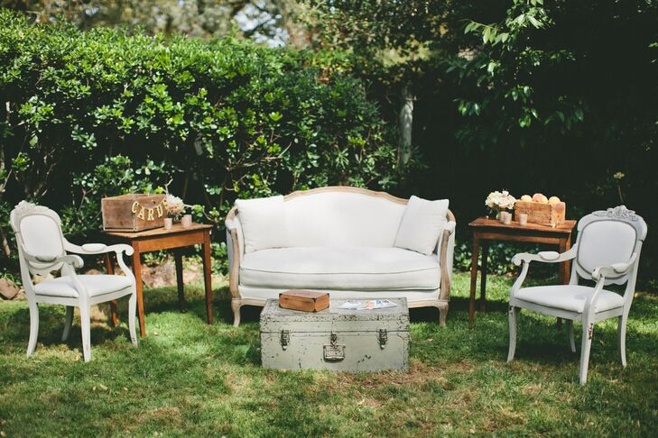 Molly and Patrick created vignettes across the lawn to create a relaxing, intimate atmosphere where guests could mix, mingle and kick back during cocktail hour. Vintage furnishings lent old warm charm and subtle rustic flair to the decor.